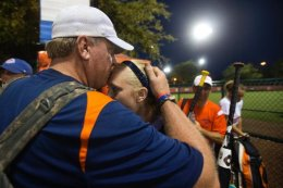 Mass Drifters Coach Curt Schilling kisses his daughter Gabriella (Gabby) after two come-from-behind victories during a USSA Girls Fastpitch World Series II.