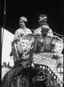 Queen Elizabeth II riding on an elephant to City Palace Jaipur, where she was hosted by the prima donna Gayatri Devi, Maharani of Jaipur.